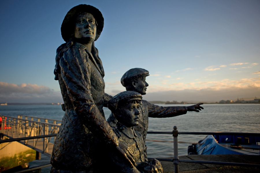 Statue of Annie Moore and her brothers on the quayside in Cobh, Ireland